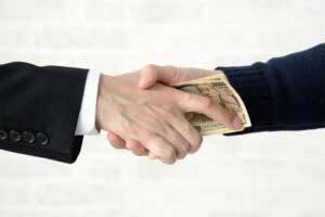 Hands shaking corruption like Jennifer Voss